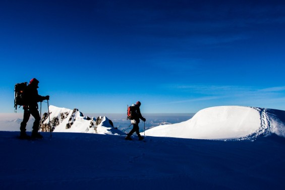 Two climbers on a snow ridge in the Alps-Jakub Cejpek